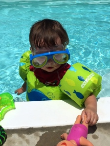 He's loving the pool this year! He does great wearing his puddle jumper, and he couldn't go without goggles the other day either! Sweet boy loves to be all decked out!