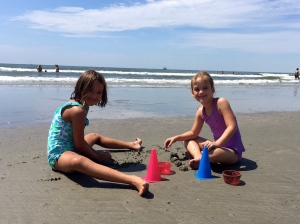 sweet girls playing in the sand!