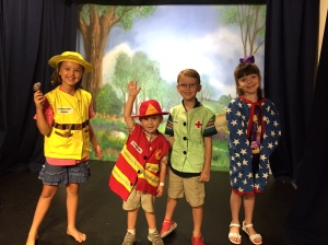 they had so much fun putting on a community helpers play for us!