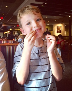 this sweet boy ate almost all of mommy and daddy's calamari at lunch one day!