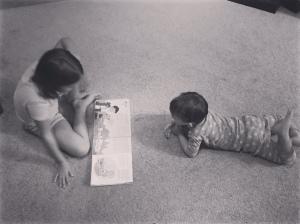 sarah ann and carson reading his cubbie lesson.