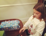 wrapping shoeboxes for a local neighborhood with my princess. she loves to serve...